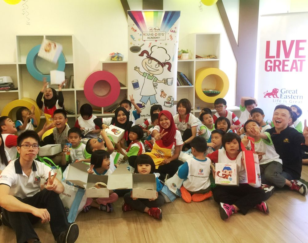 Abang Brian and Great Eastern Life ChildrenCare volunteers playing with the children after completing their baking class.