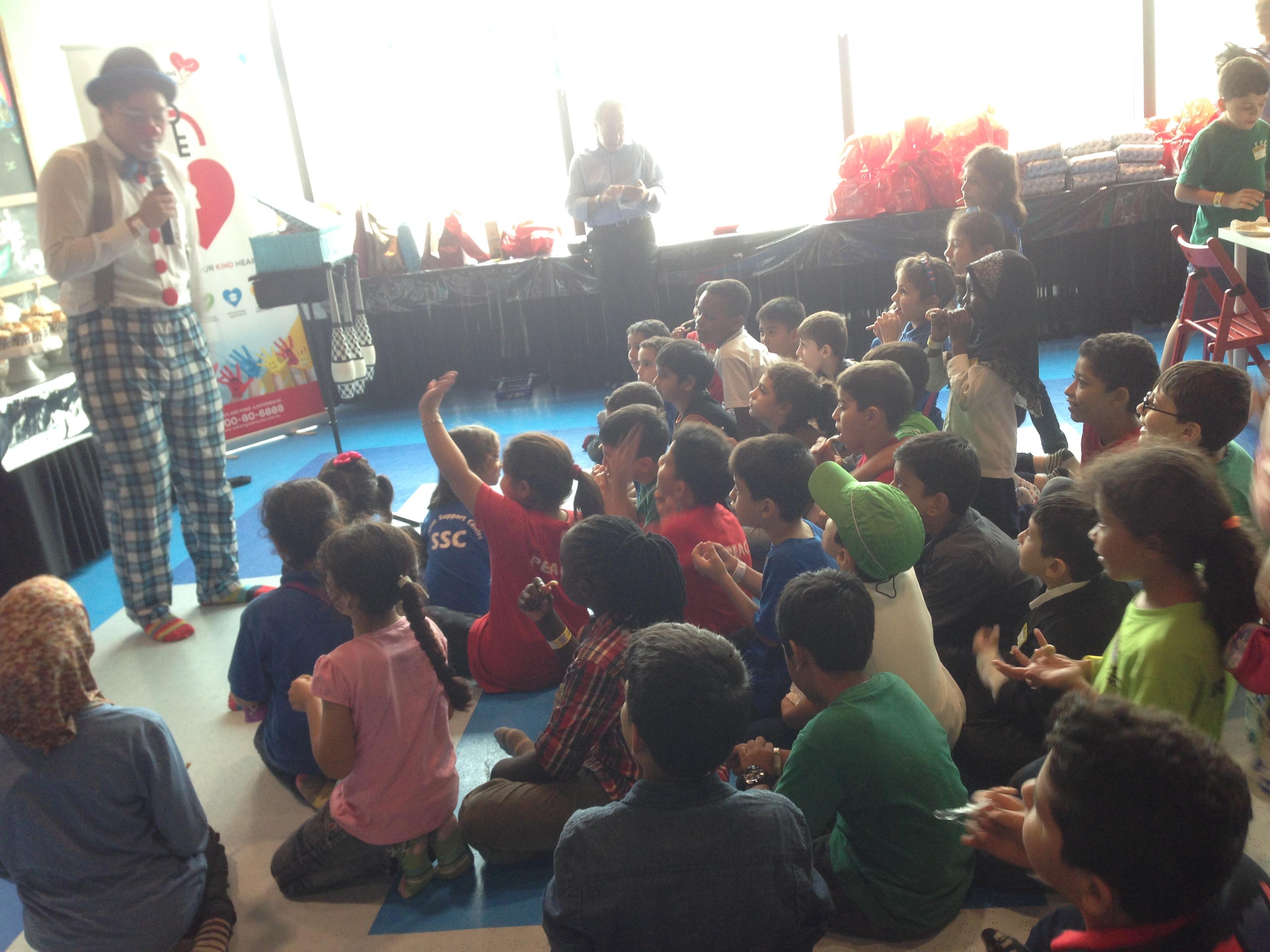Children enjoying the magic show and balloon sculpture clown.