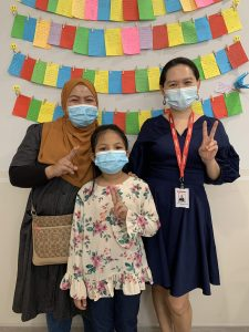 Dr Fiona (right) with patient Mia and her mother after a successful surgery leading to Mias improved eyesight